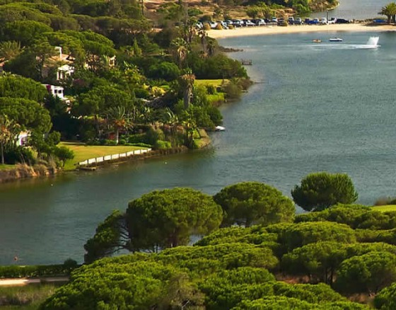 <p> South Course is the crown jewel of Quinta do Lago. Designed in 1974 by William Mitchell, who introduced Americanstandard greens, tees and bunkers to the Algarve. Soon the course gained a prestigious reputation and became a flagship in the European Tour Course. A favourite among European tour players, the 6,500 metre par 72 is set among umbrella pines, lakes and wild flowers, overlooking the serene Ria Formosa National Park. South Course has hosted the Portuguese Open eight times, including Colin Montgomerie&rsquos win in 1989. Having won 24 under par, he finished 11 strokes ahead and broke the world record with a round of 63. Its championship status however does not deter the amateur golfer. While the 8th, 15thand 18thare testing holes for low handicap players, the course&rsquos varying difficulty challenges golfers of all levels and abilities. Accurate tee shots are essential for reaching the greens, as the variety of doglegs and strategically located hazards increases the course&rsquos difficulty. The front nine holes, which wind their way through the parkland, favour a draw. While the back nine, which loop around the lake, favour a fade from the tea.</p>